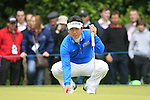 Y.E. Yang (KOR) lines up his putt on the 1st green during the Final Day of the BMW PGA Championship Championship at, Wentworth Club, Surrey, England, 29th May 2011. (Photo Eoin Clarke/Golffile 2011)
