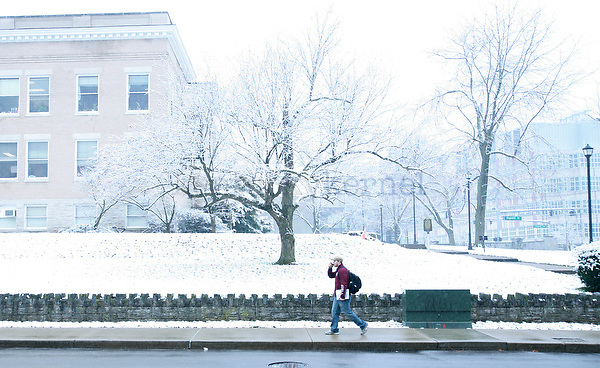 A student walks down Washington Avenue Wednesday morning after some early-morning snowfall in Lexington, Ky., on Feb. 8, 2012. Photo by Becca Clemons | STAFF