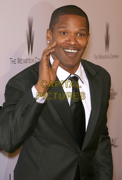 JAMIE FOXX.The Weinstein Company's 2007 Golden Globes After Party held at Trader Vic's at the Beverly Hilton Hotel, Beverly Hills, California, USA..January 15th, 2006.globe half length black suit jacket hand waving funny face.CAP/ADM/ZL.©Zach Lipp/AdMedia/Capital Pictures