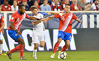 Harrison, N.J. - Friday September 01, 2017:   Kendall Waston, Christian Pulisic, David Guzmán during a 2017 FIFA World Cup Qualifying (WCQ) round match between the men's national teams of the United States (USA) and Costa Rica (CRC) at Red Bull Arena.