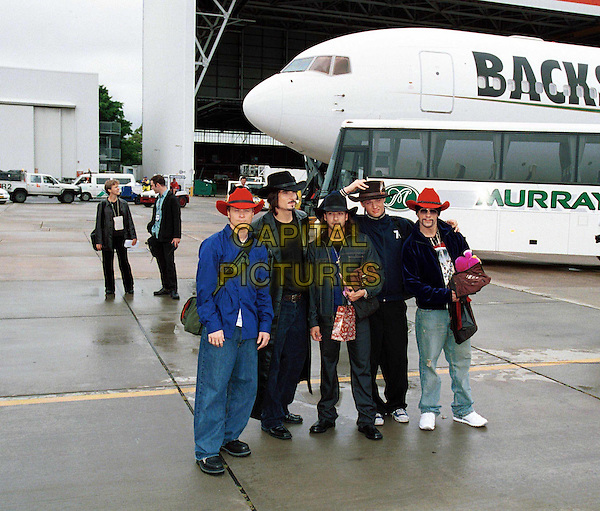 THE BACKSTREET BOYS IN AUSTRALIA..Ref: IJ(CD)..cowboy hat, stetson, boyband, at airport, private plane, full length, full-length..www.capitalpictures.com..sales@capitalpictures.com..©Capital Pictures..