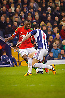Saturday, 9 March 2013<br /> <br /> Pictured: Roland Lamah of Swansea City is challenged by Liam Ridgewell of West Bromwich Albion <br /> <br /> Re: Barclays Premier League West Bromich Albion v Swansea City FC  at the Hawthorns, Birmingham, West Midlands