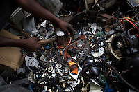 Copper is retrieved from a computer monitor at Agbogbloshie dump, which has become a dumping ground for computers and electronic waste from all over the developed world. Hundreds of tons of e-waste end up here every month. It is broken apart, and those components that can be sold on, are salvaged.