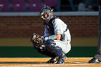 Catcher Zane Evans #10 of the Georgia Tech Yellow Jackets looks to his dugout for a sign during the game against the Wake Forest Demon Deacons at Gene Hooks Field on April 16, 2011 in Winston-Salem, North Carolina.  Photo by Brian Westerholt / Four Seam Images