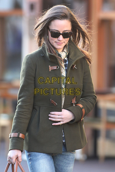 Pippa Middleton arrives for work, London, England..December 20th, 2011.half length brown khaki jacket sunglasses shades check shirt black jeans denim brown scarf.CAP/HIL.©John Hillcoat/Capital Pictures .