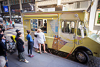 The Van Leeuwen artisanal ice cream  truck in Soho in New York on Sunday, June 7, 2015. The truck sells ice cream and coffee drinks on the streets of New York in different locations. (© Richard B. Levine)