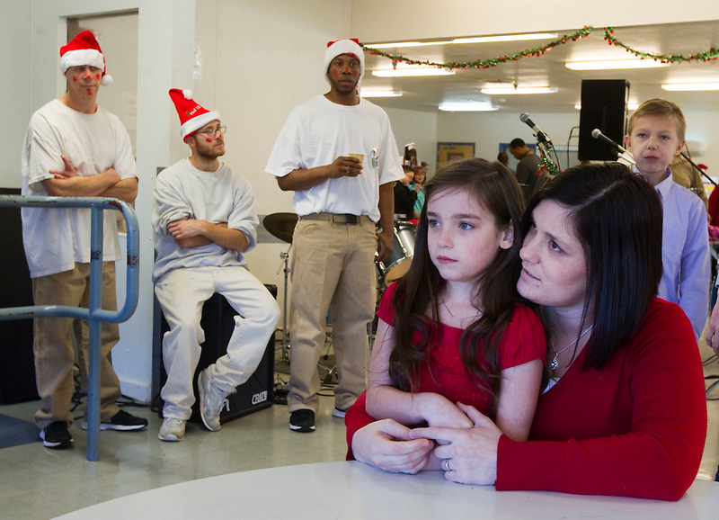 Melody and her daughter Abigail wait for father Chris Partridge to arrive at the Larch Corrections Center cafeteria to celebrate in Yacolt Sunday December 14, 2014. (Natalie Behring/ The Columbian)