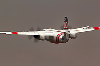 S-2F3AT Tracker, CDF 100, departs the Grass Valley Air Attack Base and flies into the smoke filled Northern California skies enroute to a wildfire.