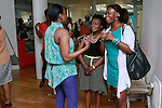 Nana Eyeson-Akiwowo (blue pants) speaks with guests during the African Health Now - Fashion Fete event, at the Tracy Reese store on 641 Hudson Street, June 20, 2013.