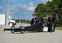 Jan. 16, 2013; Jupiter, FL, USA: Crew members push the car of NHRA top fuel dragster driver Brittany Force during testing at the PRO Winter Warmup at Palm Beach International Raceway.  Mandatory Credit: Mark J. Rebilas-