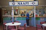 NAAFI cafe women talking at counter Norfolk  Suffolk aviation museum Flixton Bungay England.