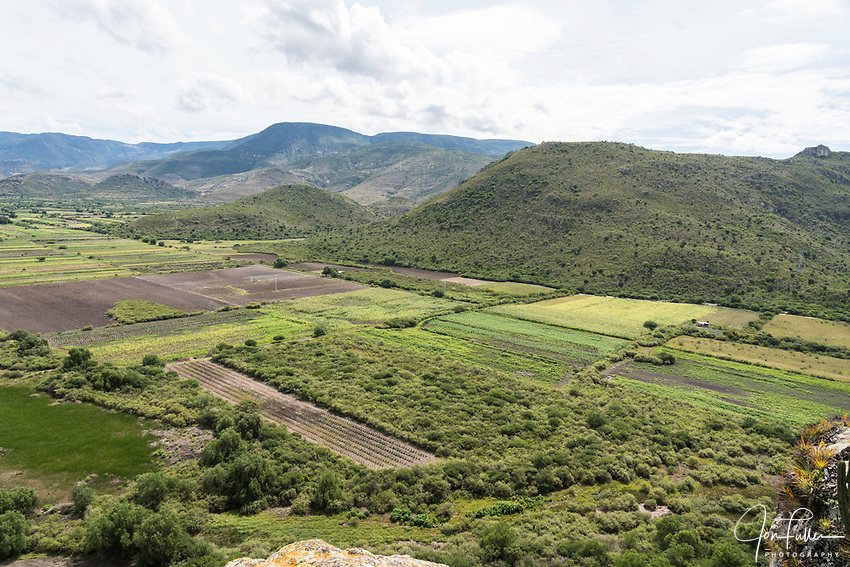 A view of the Tlacolula Valley from the fortress hill at Yagul, Oaxaca, Mexico.  An agave field can be seen at lower left.