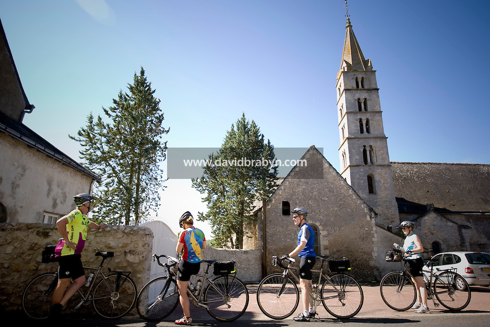 Participants in a Backroads cycle tour of the Loire Valley stop in a village, France, 25 June 2008.
