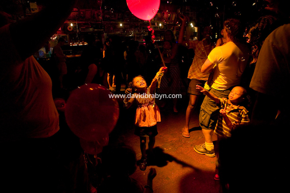 4 year-old Speshelle (C) attends a Baby Loves Disco event at Southpaw nightclub in the Park Slope neighborhood of Brooklyn in New York City, USA, 6 October 2007. In two years, Baby Loves Disco, a midday soiree specifically for the Mommy-and-me set, has become a nationwide phenomenon. One afternoon each month, local organizers take over a nightclub, complete with a cash bar and DJ and throw open the doors to anyone under the age of 7, accompanied by parents.
