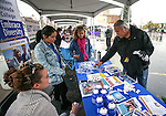 Residents check out the booths in Arlington Square during the Road to the Future celebration in downtown Carson City, Nev. on Friday, Oct. 28, 2016. <br />