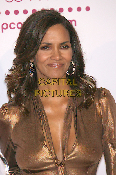 HALLE BERRY (winner Favorite Female Action Star).The 33rd Annual People's Choice Awards - Press Room held at The Shrine Auditorium, Los Angeles, California, USA..January 9th, 2007.headshot portrait gold metallic hoop earrings.CAP/ADM/ZL.©Zach Lipp/AdMedia/Capital Pictures