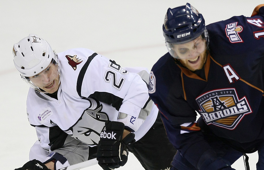 San Antonio Rampage's Petr Prucha, left, races Oklahoma City Barons' Jake Taylor to the puck during the second period of an AHL hockey game, Friday, Dec. 31, 2010, at the AT&T Center in San Antonio. (Darren Abate/pressphotointl.com)