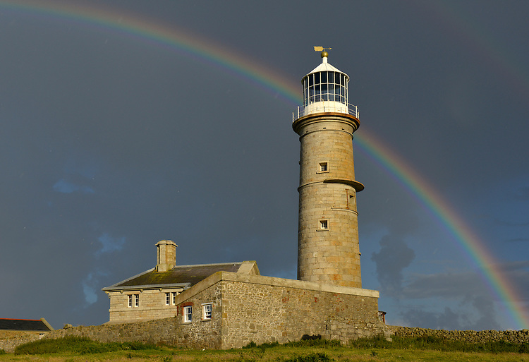 Summer rainbow over The Old Light, Lundy