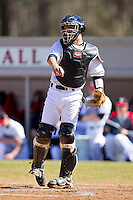 Catcher Daniel Gerow #15 of the Davidson Wildcats makes a throw to third base following a strikeout by a College of Charleston Cougars batter at Wilson Field on March 12, 2011 in Davidson, North Carolina.  The Wildcats defeated the Cougars 8-3.  Photo by Brian Westerholt / Four Seam Images