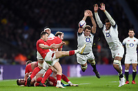 Gareth Davies of Wales box-kicks the ball as Joe Launchbury and Courtney Lawes of England look to charge him down. Natwest 6 Nations match between England and Wales on February 10, 2018 at Twickenham Stadium in London, England. Photo by: Patrick Khachfe / Onside Images