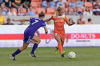 Rachel Daly (3) of the Houston Dash passes the ball while Stephanie Catley (7) of the Orlando Pride attempts to defend on Friday, May 20, 2016 at BBVA Compass Stadium in Houston Texas. The Orlando Pride defeated the Houston Dash 1-0.