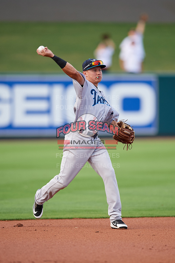 Tampa Tarpons shortstop Diego Castillo (19) throws to first base during a game against the Lakeland Flying Tigers on April 5, 2018 at Publix Field at Joker Marchant Stadium in Lakeland, Florida.  Tampa defeated Lakeland 4-2.  (Mike Janes/Four Seam Images)