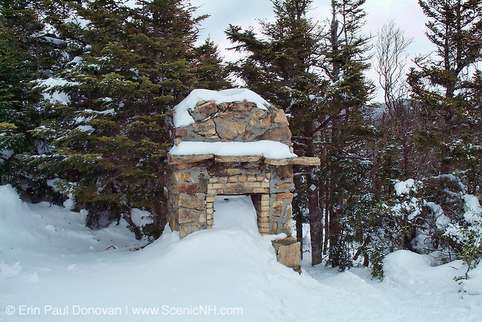 The remains of a stone fireplace from an old shelter that was once on the summit of Mount Starr King in the White Mountains of New Hampshire USA.