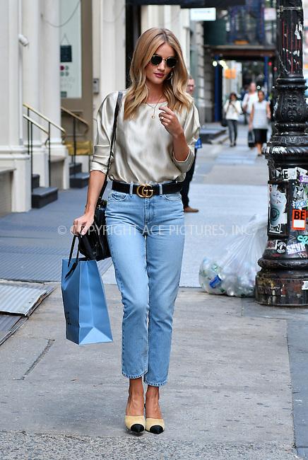 www.acepixs.com<br /> <br /> September 16 2016, New York City<br /> <br /> Model Rosie Huntington-Whiteley went shopping in Soho on September 16 2016 in New York City<br /> <br /> By Line: Curtis Means/ACE Pictures<br /> <br /> <br /> ACE Pictures Inc<br /> Tel: 6467670430<br /> Email: info@acepixs.com<br /> www.acepixs.com