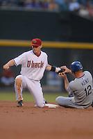 Jun 25, 2007; Phoenix, AZ, USA; Los Angeles Dodgers second baseman (12) Jeff Kent grabs the glove of Arizona Diamondbacks shortstop (6) Stephen Drew after being caught stealing in the second inning at Chase Field. Mandatory Credit: Mark J. Rebilas