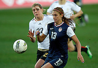 USA's Alex Morgan fights for the ball with Germany's Luisa Wensing during their Algarve Women's Cup soccer match at Algarve stadium in Faro, March 13, 2013.  .