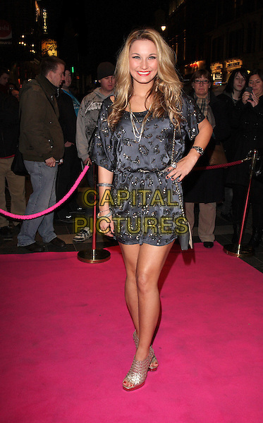 SAM FAIERS.Press night for 'My Trip DownThe Pink Carpet' at the Apollo Theatre, Shaftesbury Avenue, London, England..February 3rd 2011.full length black shoes grey gray print silver ankle dress silk satin open toe hand on hip.CAP/ROS.©Steve Ross/Capital Pictures