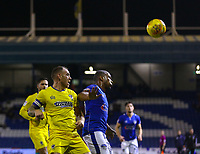 AFC Wimbledon's Barry Fuller (L) puts pressure Oldham Athletic's Gevaro Nepomuceno (R)  during the Sky Bet League 1 match between Oldham Athletic and AFC Wimbledon at Boundary Park, Oldham, England on 21 November 2017. Photo by Juel Miah/PRiME Media Images