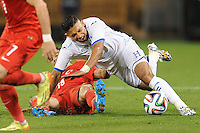 Washington, D.C.- May 29, 2014. Honduras defender Emilio Izaguirre gets fouled by Turkey defener Caner Erkin.  Turkey defeated Honduras 2-0 during an international friendly game at RFK Stadium.
