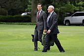 Special Advisor to President Trump Jared Kushner, left, and White House Chief of Staff John Kelly, right, board Marine One as United States President Donald departs the White House on June 27, 2018 in Washington, DC. <br /> Credit: Alex Edelman / CNP