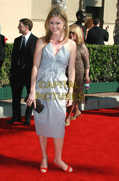 JULIE BOWEN.2006 Creative Arts Emmy Awards held at the Shrine Auditorium, Los Angeles, California, USA..August 19th, 2006.Ref: ADM/CH.full length blue strapless dress clutch purse black.www.capitalpictures.com.sales@capitalpictures.com.©Charles Harris/AdMedia/Capital Pictures