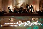 The band plays as lighting displays entertain guests. Olympic gold medalist, Sanya Richards, and New York Giants cornerback, Aaron Ross, wed at the Hyde Park Baptist in Austin, Texas on Friday, February 26, 2010...