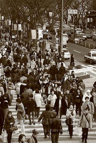Mar 7, 2006; Tokyo, JPN; Harajuku.Pedestrians flood the streets at a busy intersection and crosswalk at quitting time in Harajuku...Photo credit: Darrell Miho