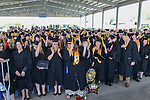 Their diplomas in hand, graduates flip their tassles at the conclusion of the 2015 Western Nevada College Commencement held at the Pony Express Pavilion in Carson City, Nev., on Monday, May 18, 2015.<br /> Photo by Tim Dunn
