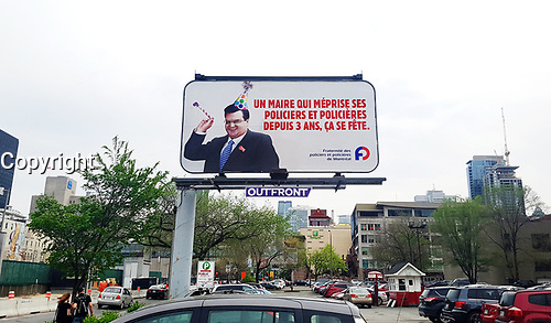 A billboard set up by Montreal's police brotherhood on Viger Street East, at de Bullion Street, on the day of Montreal's 375th anniversary, to denounce mayor Denis Coderre, May 17th, 2017.