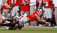 Ohio State Buckeyes wide receiver Devin Smith (9) makes a catch against Wisconsin at Ohio Stadium on September 28, 2013.  (Chris Russell/Dispatch Photo)