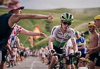 Tom-Jelte Slagter (NED/Dimension Data) deliberately slapped on the helmet by a bystander up the last climb of the 2018 Tour: the Col d'Aubisque (HC/1709m/16.6km@4.9%)<br /> <br /> Stage 19: Lourdes > Laruns (200km)<br /> <br /> 105th Tour de France 2018<br /> ©kramon