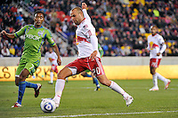 Joel Lindpere (20) of the New York Red Bulls plays the ball as James Riley (7) of the Seattle Sounders defends. The New York Red Bulls defeated the Seattle Sounders 1-0 during a Major League Soccer (MLS) match at Red Bull Arena in Harrison, NJ, on March 19, 2011.