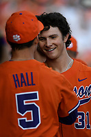 Center fielder Bryce Teodosio (31) of the Clemson Tigers is congratulated by Ryan Hall after scoring his first collegiate run in a game against the William and Mary Tribe on February 16, 2018, at Doug Kingsmore Stadium in Clemson, South Carolina. Clemson won, 5-4 in 10 innings. (Tom Priddy/Four Seam Images)