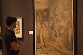 "Pictured: A man stands in front of the picture ""Lamentation of Christ"", 1593 by Andrea Andreani (1558/59-1629) after Alessandro Casolani. Press preview of the exhibition ""Renaissance Impressions: Chiaroscuro Woodcuts from the Collections of Georg Baselitz and the Albertina, Vienna"", opens at the Royal Academy of Art on 15 March 2014. The exhibition at the Sackler Wing of Galleries runs from 15 March to 8 June 2014 and presents over 150 rare prints by the chief practitioners of the Chiaroscuro woodcutting technique in Germany, Italy and the Netherlands held at the Albertina Museum in Vienna and in the personal collection of the Honorary Royal Academian Georg Baselitz."