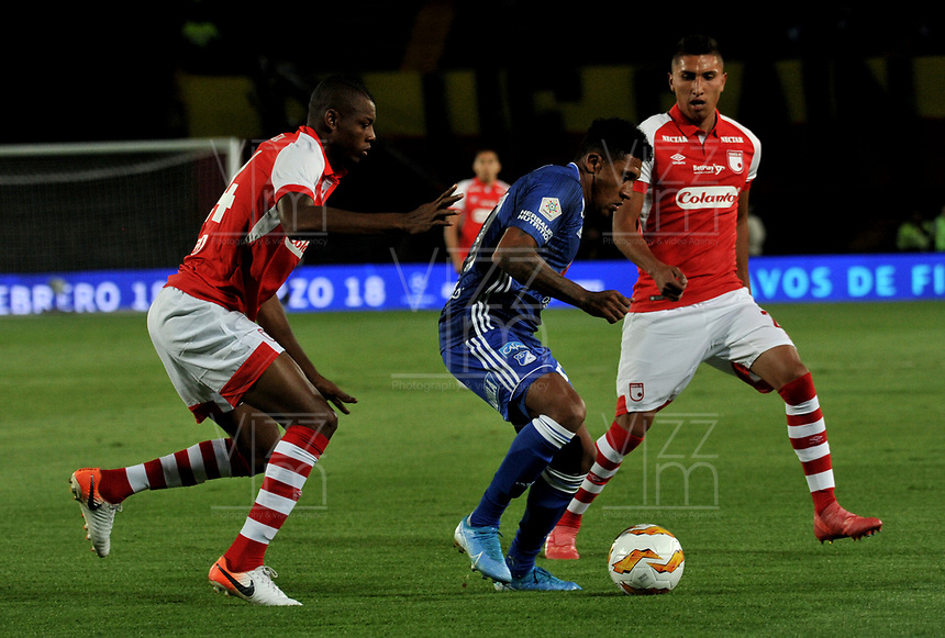 BOGOTÁ-COLOMBIA, 15-01-2020: Jose Ortiz de Millonarios y Jeisson Palacios, Alexander Porras de Independiente Santa Fe disputan el balón, durante partido Millonarios y el Independiente Santa Fe, por el Torneo ESPN 2020, jugado en el estadio Nemesio Camacho El Campin de la ciudad de Bogotá. / Jhon Duque of Millonarios and Jeisson Palacios, Alexander Porras of Independiente Santa Fe vie for the ball, during a match between Millonarios and Independiente Santa Fe, for the ESPN Tournament 2020, played at the Nemesio Camacho El Campin stadium in the city of Bogota. Photo: VizzorImage / Luis Ramírez / Staff.