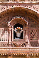Jodhpur at Fort Mehrangarh in Rajasthan India. Man at window of Fort Palace