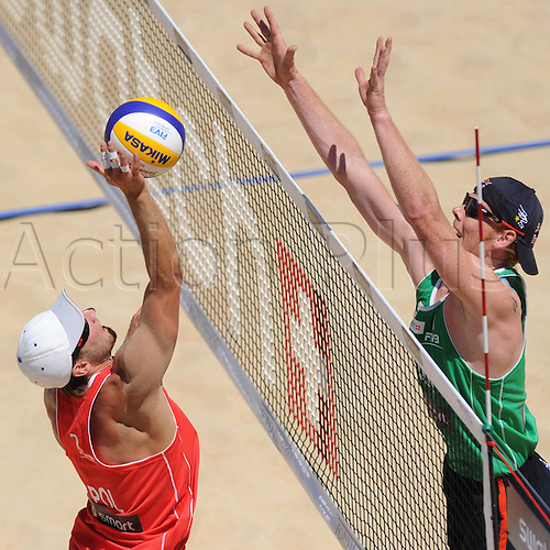 18 06 2011 Rome, Italy.  Beach volleyball FIVB World Cup 2011 Rome Italy  Beach Volleyball FIVB World Championships for men Picture shows Grzegorz Fijalek POL and Jonas Reckermann ger