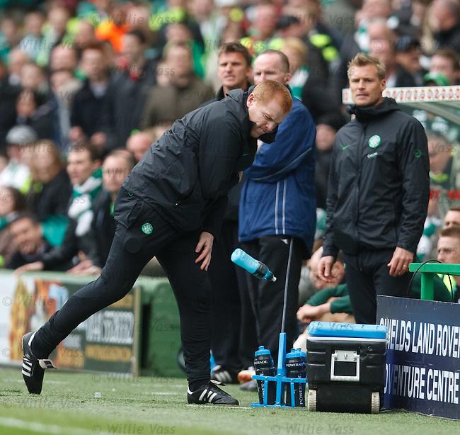 Neil Lennon hurls a bottle of Poerade in fustration as Celtic struggle early in the second half