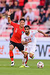 Ali Jaafar Madan of Bahrain (R) fights for the ball with Jung Wooyoung of South Korea (L) during the AFC Asian Cup UAE 2019 Round of 16 match between South Korea (KOR) and Bahrain (BHR) at Rashid Stadium on 22 January 2019 in Dubai, United Arab Emirates. Photo by Marcio Rodrigo Machado / Power Sport Images