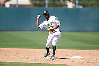 Oakland Athletics second baseman Marcos Brito (3) prepares to make a throw to first base during an Instructional League game against the Cincinnati Reds on September 29, 2017 at Lew Wolff Training Complex in Mesa, Arizona. (Zachary Lucy/Four Seam Images)